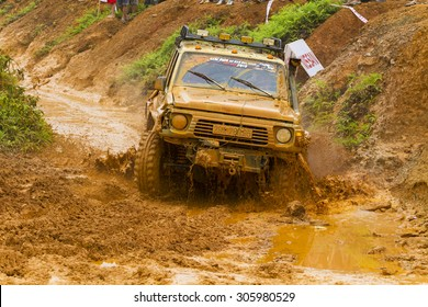 Hanoi, Vietnam - July 5, 2015: 4x4 SUV offroading with mud road, competitor adventure in Vietnam Off-road Cup (VOC). VOC is an yearly event public for everybody in Vietnam.