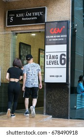 Hanoi, Vietnam - July 7, 2017: GV Cinemas sign at Vincom center Ba Trieu building, with people walking into the building