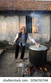 Hanoi, Vietnam - Jun 22, 2017: Cooking Chung cake outdoor in communal house at So village, Quoc Oai district. , square glutinous rice cake, Vietnamese lunar new year food