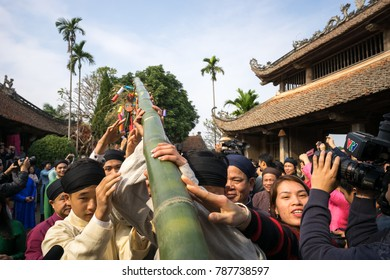 Hanoi, Vietnam - Jun 22, 2017: Raising Neu tree rituals in communal house at So village, Quoc Oai district. The bamboo pole placed in front of house on the last day of the lunar year to expel evils