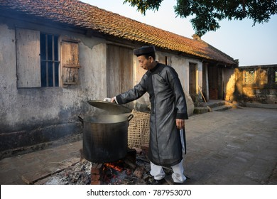 Hanoi, Vietnam - Jun 22, 2017: Cooking Chung cake outdoor in communal house at So village, Quoc Oai district. Square glutinous rice cake, Vietnamese lunar new year food