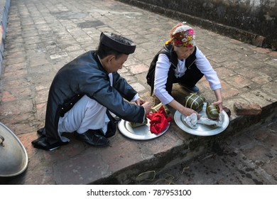 Hanoi, Vietnam - Jun 22, 2017: People take Chung cake out of cooking pot at So village, Quoc Oai district. Square glutinous rice cake, Vietnamese lunar new year food