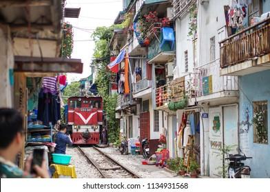 HANOI, VIETNAM - JUN, 29, 2018: A train run through an ancient town in Hanoi.