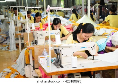 HANOI, VIETNAM - JUNE, 10, 2013: Workers work in a garment factory.