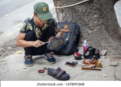 Hanoi, Vietnam -June 12, 2019: Old quarter of Hanoi, shoe shine on the streets of asia