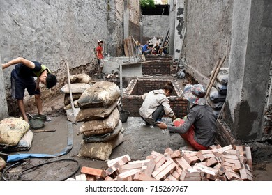 Hanoi, Vietnam - June 23, 2017: Labourers work on a construction site in the city centre.