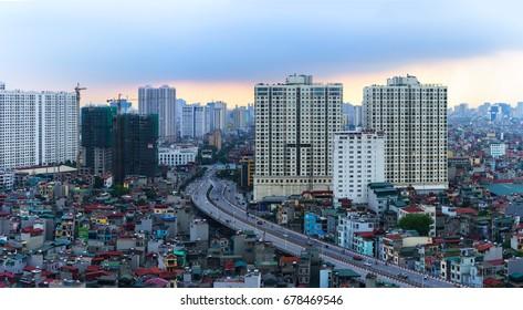 Hanoi, Vietnam - June 5, 2017: Aerial skyline view of Hanoi cityscape by twilight period, with Minh Khai street to Vinh Tuy bridge, Hai Ba Trung district.