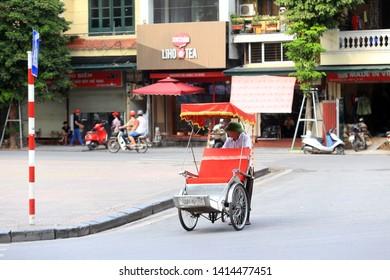 Hanoi, Vietnam : Life in vietnam, Cyclo beside Sword lake on May 30, 2019