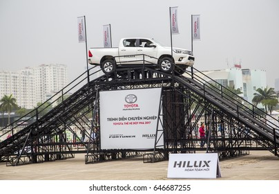 Hanoi, Vietnam - Mar 12, 2017: Toyota Hilux pick-up 2017 car in a test drive for ability on multi terrains in test drive for  public everybody in Hanoi, Vietnam.