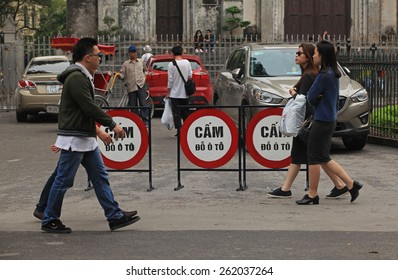 Hanoi, Vietnam - Mar 15, 2015: Daily street life in Vietnam. People walking on a street of Hanoi capital with no parking sign.