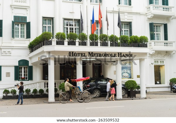 Hanoi, Vietnam - Mar 15, 2015: External front view of Hotel Sofitel Legend Metropole Hanoi with running cyclo. Sofitel Legend Metropole Hanoi is a well-known French architecture in Vietnam.