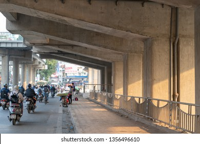 Hanoi, Vietnam - Mar 21, 2019: Traffic under elevated electric train road on Lang street