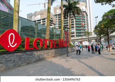 Hanoi, Vietnam - Mar 21, 2019: Lotte Mart logo sign of Lotter Center Hanoi at Dao Tan - Lieu Giai street, with logo sign and advertisement banners