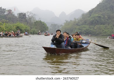 Hanoi, Vietnam, March 15, 2015: Boat on the way to go to the Huong Pagoda. HUONG Pagoda Festival is the biggest and longest annual festival in VIETNAM