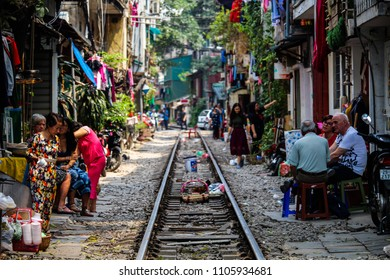 Hanoi, Vietnam - March 15, 2018: People living their daily life in the middle of Hanoi's Train Street. Credit: Dino Geromella/Shutterstock
