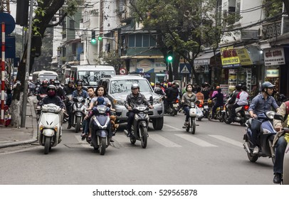 HANOI, VIETNAM - MARCH 18, 2016: Hundreds of motobikes and motor scooters are crowding the streets of Hanoi, Vietnam.