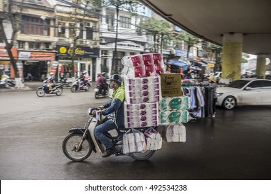 HANOI, VIETNAM - MARCH 19, 2016: Transport of a heavy load on a moped in the streets of central hanoi, Vietnam.