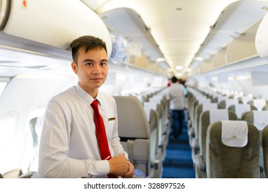 HANOI, VIETNAM - MAY 11, 2015: crew member meet passengers in the aircraft of Vietnam Airlines. Vietnam Airlines has a network within East Asia, Southeast Asia, Europe and Oceania.