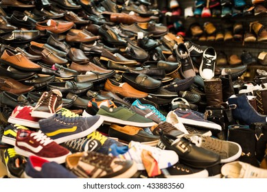 HANOI, VIETNAM - MAY 15, 2014: Shoes on shelf in a shop in Dong Xuan market in Hanoi, Vietnam.
