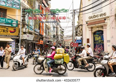 Hanoi, Vietnam - May 18, 2016: Busy motorbike traffic in the Old Quarter in Hanoi. In recent decades, motorbikes have overtaken bicycles as the main form of transportation causing frequent gridlocks.