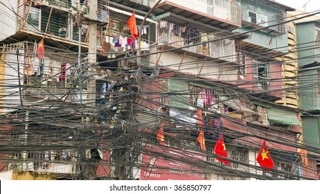 HANOI, VIETNAM - MAY 2014:  Slums with messy electric cables