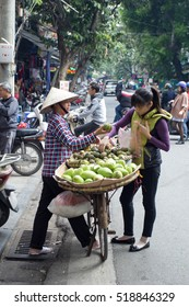 Hanoi, Vietnam, Nov 11, 2016: Street vendors in Phoco Hanoi (Hanoi's Old Quarter) It is one of some specific cultural features of Hanoi. They sell everything from flowers to foods to anything