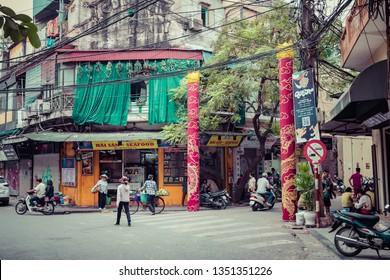 HANOI, VIETNAM - NOVEMBER 16, 2018 : The street vendors in Hanoi, Vietnam. Early morning on a busy street in city center.