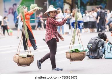 Hanoi Vietnam November 21 2017 Life in Vietnam- Hanoi,Vietnam Street vendors in Hanoi's Old Quarter. Street vendors sell a lot of things, fruits, flowers, personal items, etc..