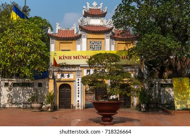 Hanoi, Vietnam - November 23, 2016: The colorful entry gate to the famous One Pillar Pagoda