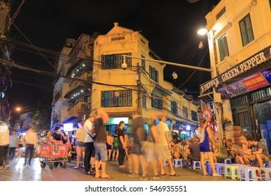 HANOI VIETNAM - NOVEMBER 25, 2016: Unidentified people vist bars and restaurants in Old Quater.