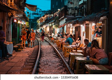 HANOI, VIETNAM - OCT 02, 2019 : Restaurants near train street in Hanoi at night.