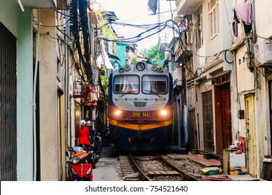 HANOI, VIETNAM - OCT, 29, 2017: A train run through an ancient town in Hanoi.