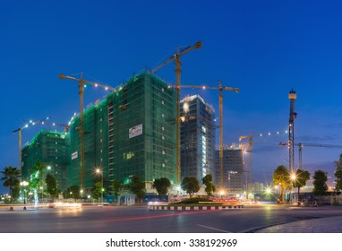 Hanoi, Vietnam - Oct 5, 2015: Apartment building construction site at night, Park Hill 3, in Times City complex. Times City is product of Vingroup, the biggest estate company in Vietnam