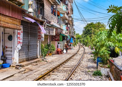 HANOI, VIETNAM - OCTOBER 15, 2018: City railway Perspective view running along narrow street with houses