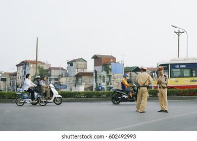 Hanoi, Vietnam - October 16, 2016: Unidentified riders ride motorbikes on busy road on October 16, 2016 in Hanoi, Vietnam.Motorbike is the most favorite vehicle for Hanoians
