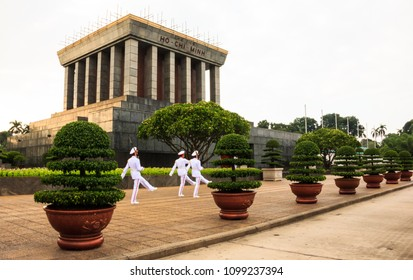 Hanoi, Vietnam - October 20, 2017: Ho chi minh mausoleum with white uniform soldiers marching in front to patrol the area. One of popular tourist attractions, landmarks, travel destinations in Hanoi.