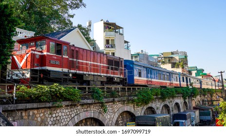 HANOI, VIETNAM- OCTOBER 28, 2019: Red locomotive at the Long Bien railway station. It is a railway station in Hanoi, Vietnam on the Long Bien Bridge