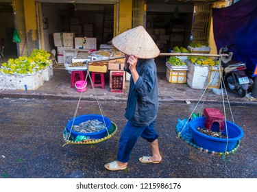 HANOI , VIETNAM - SEP 06 : Vendor in a market in Hanoi Vietnam on September 06 2018. Markets in Hanoi are always bustling with hundreds of stalls selling fresh products