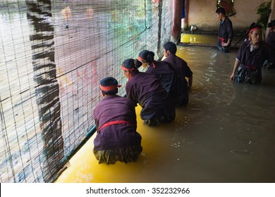 Hanoi, Vietnam - Sep 20, 2015: Common Vietnamese water puppets behind puppetry state. The control room is dark to hide puppeteers and instruments