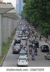 HANOI, VIETNAM - SEP 21, 2014: Unidentified vehicles on a busy road in Hanoi, Vietnam. Motorbike is the most favorite vehicle for Vietnamese, and Hanoi is called the motorbike city.