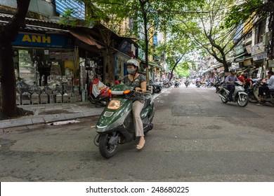 HANOI, VIETNAM - SEP 23, 2014: Unidentified Vietnamese people in the street of Hanoi. 92% of Vietnamese people belong to the Viet ethnic group