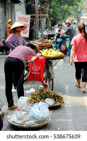 Hanoi, Vietnam - Sept 15, 2016, Mid-Autumn of Vietnam. People stroll around Hang Ma Street (a street in center of the old quarter that sells goods Hanoi's mid-autumn festival) in goods is everywhere.