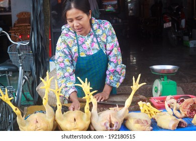 HANOI, VIETNAM - SEPT 29: unidentified woman sells chicken meat in a food market, on September 29, 2013, in Hanoi, Vietnam.