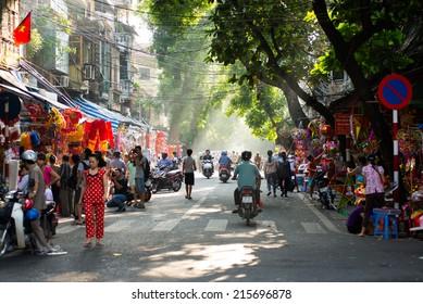 HANOI, VIETNAM - SEPT 5, 2014: Hanoi town in autumn on September 5, 2014 in Hanoi, Vietnam. Popular transportation in Hanoi street is motorbike.