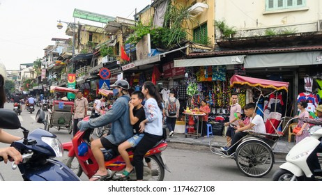 Hanoi - Vietnam. September 01, 2018.Busy street corner in old town Hanoi Vietnam.Most vehicles on the roads of Vietnam are motorcycles and scooters.