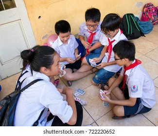 Hanoi, Vietnam - September 24, 2015: Pupils are playing cards after school time
