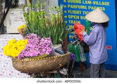 Hanoi Vietnam September 26  2016 Life of small street corner in Hanoi.Street vendors sell a lot of things, fruits, flowers, personal items, etc..