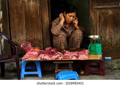Hanoi, Vietnam-28 November 2014:Unidentified vendor at a market in Hanoi city.Vietnamese meat seller. Life in Vietnam