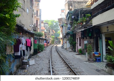 HANOI/ VIETNAM_06 Nov 2018: Hanoi train street with railroad passing through the neighborhood representing bad living conditions.