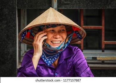 Hanoi, Vietnam-August 27, 2018: Portrait of Vietnamese woman taking on moblie phone on street in Hanoi, Vietnam